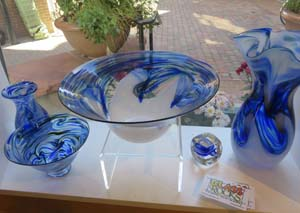 Glassware by Dottie Boscamp in the window of Trimble Court Artisans