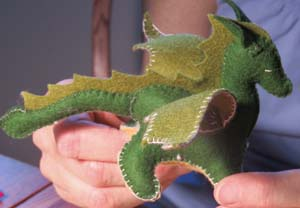 Dragons of wool felt are among the handmade  inhabitants of HollysMeadow.