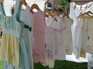 Heirloom linen upcycled to little girl dresses by Kristin McMahan