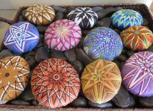 River rocks decorated by fiber artist Becky Margenau