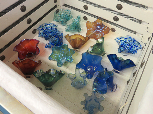 Glass bowls by Dottie Boscamp cool in a kiln.