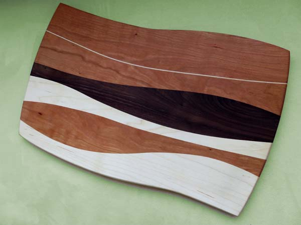 Cutting board of maple, cherry, and walnut by Mike Wilkinson