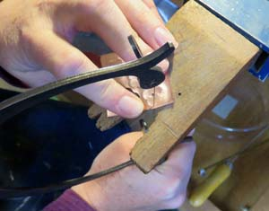 Jennie Milner uses a Jeweler's saw to cut out designs for her jewelry.