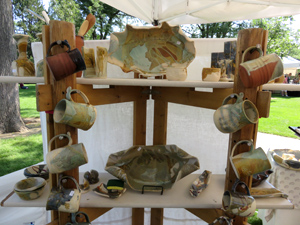 These functional ceramics from Dot's Pots were on display at one of many booths during Loveland's Art in the Park in August of 2014.