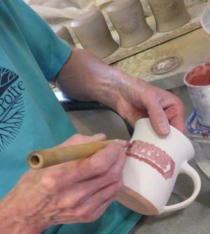 A mug in the works at Elk Falls Pottery