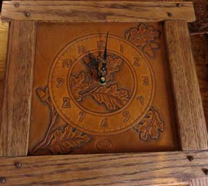 Wall clock of wood and leather by Jeff Icenhower