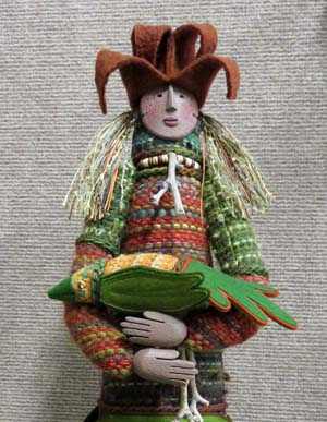 Mythical figure dressed in handwoven wool, created by Alice Watterson