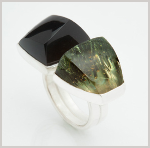 This ring designed and created by Ryan Gardner includes _________ and ________ set on __________ .