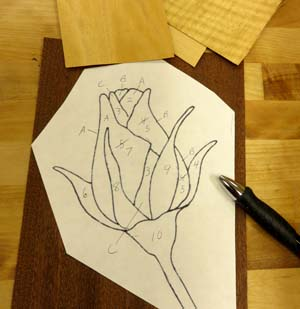 A simple pattern makes a good first project in marquetry.