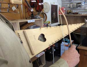 Mike Medeiros plays the bowed psaltery he made.